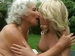 Kissing Lesbian Old And Young Outdoor