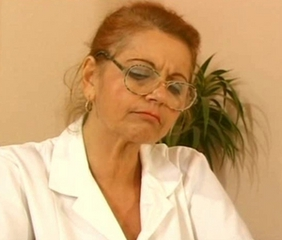 Doctor Glasses Mature Redhead